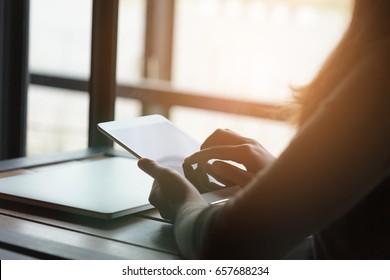 woman using digital tablet in coffee shop restaurant