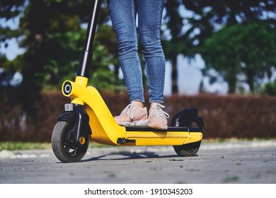 Woman using electric scooter for fast mobile active riding through the city