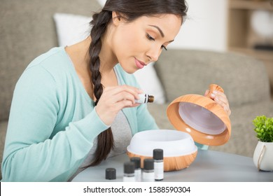 A woman using essential oil