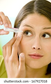 Woman Using Eye Lotion