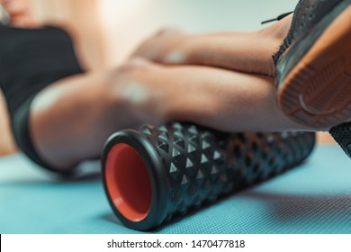 Woman Using Foam Roller for Muscle and Fascia Stretching