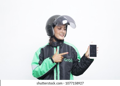 woman is using Grab application on smartphone. Grab is a Malaysian technology company that offers ride-hailing and logistics services through its app. yogyakarta indonesia. april 26, 2018