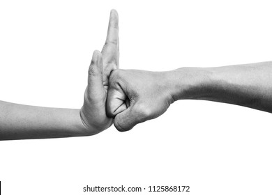 woman using hand palm to stop man's punch from attack isolated on white background. stop violence against women campaign concept with copy space, black and white color