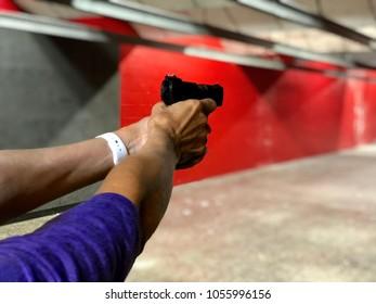 Woman using a handgun at shooting range