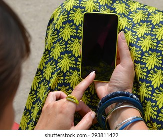 Woman using her cell phone.