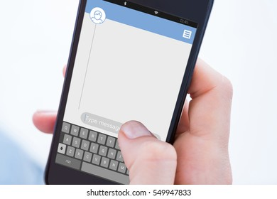Woman using her mobile phone against smartphone text messaging