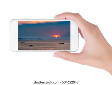 Woman using her smart phone searching the travel information Beautiful aerial view of sea at sunrise and twilight time with the shade of shadow boat. Traveling concept, isolated on white background.