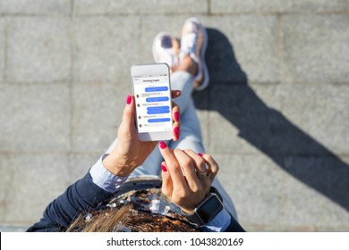 Woman using instant messaging app on mobile phone