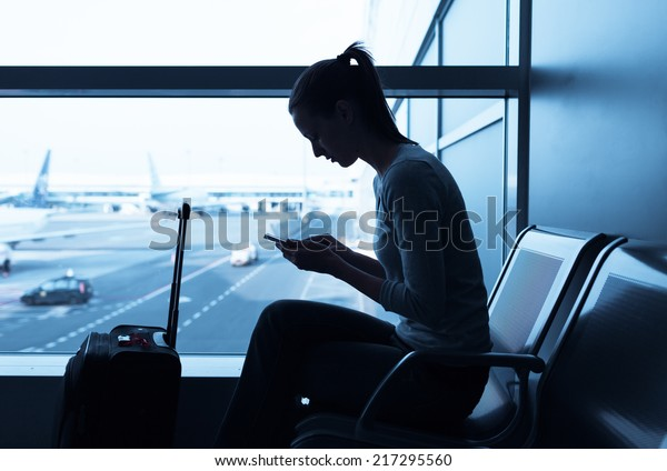 Woman using internet in the airport terminal