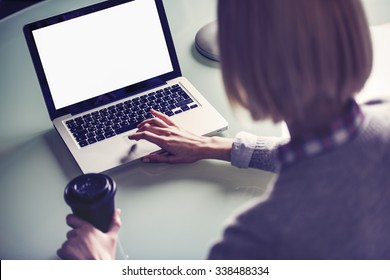 a woman is using a laptop computer view from above shoulder