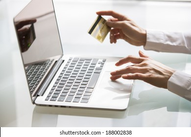 Woman using laptop and credit card.shopping online. close-up