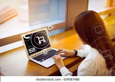 Woman using laptop payments online shopping and icon customer network connection on screen, m-banking and connecting with omni channel vendor. Internet of thing, Multi-channel or Omni channel concept.
