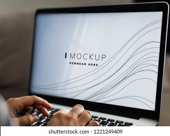 Woman using a laptop with a screen mockup
