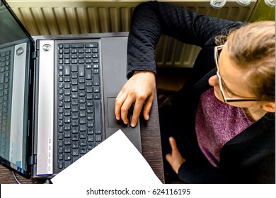 Woman using laptop, top view, concept of people working in the office