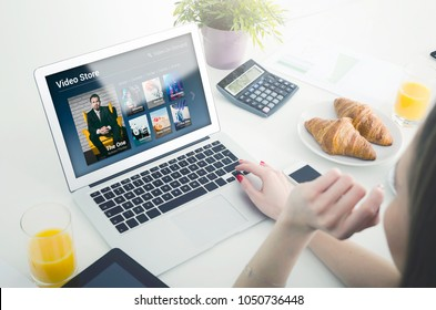 Woman using laptop for watching movie on VOD service. Video On Demand television internet stream multimedia concept