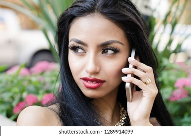 Woman using listening or talking on cell phone outside