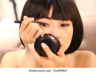 Woman using makeup.