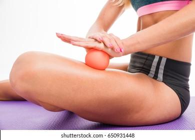 A woman using a massage ball