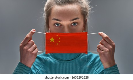 Woman using medical protective mask to health protection from chinese virus, epidemic and infectious diseases. 2019 Novel Coronavirus (2019 ncov) concept during occurs in Wuhan. China hold on