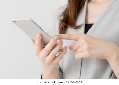 Woman using mobile phone, business