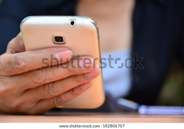 Woman using mobile phone for connection and business