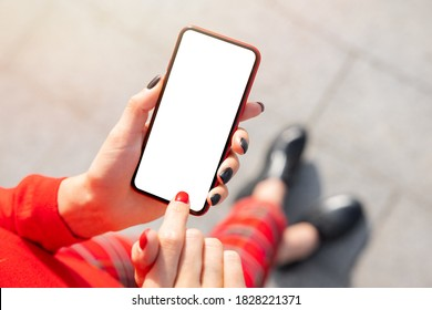 Woman using mobile phone, empty mockup screen for your own design