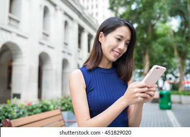 Woman using mobile phone at outdoor