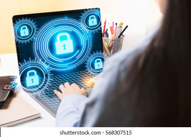 Woman using modern laptop computer with Cyber Security