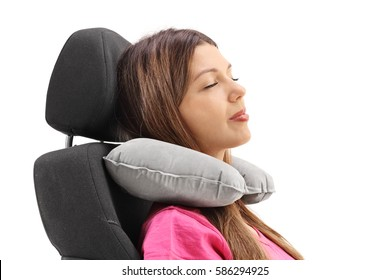 Woman using a neck pillow and resting on a seat isolated on white background
