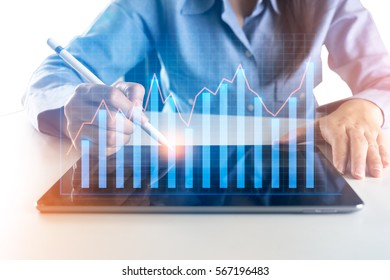 Woman using new modern tablet with investment graph.