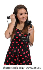 Woman using an old timey vintage candlestick phone