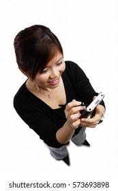 Woman using PDA, high angle view