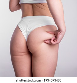 A woman using pinch test as one of the methods for measuring body fat stock photo