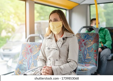 Woman using public transport during covid-19 crisis wearing face mask