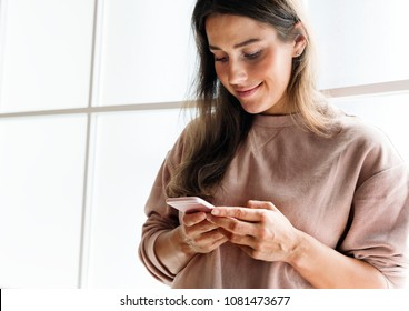 Woman using a smarphone social media conecpt