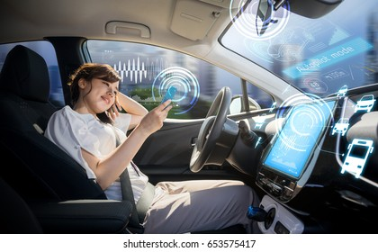 woman using smart phone in autonomous car. self driving vehicle. driverless car. autopilot. automotive technology.