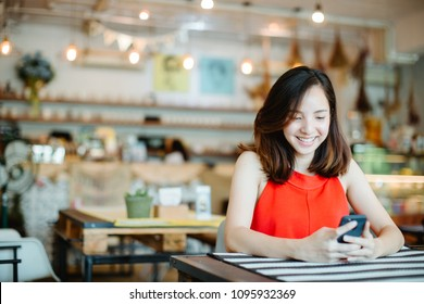 woman using smart phone in cafe.