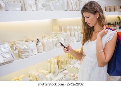 Woman using smartphone at a beauty salon