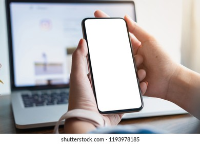 woman using Smartphone. Blank screen mobile phone for graphic display montage.networking service.