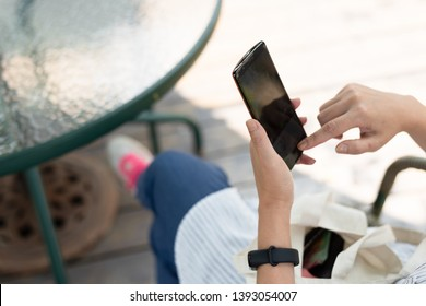 woman using smartphone, concept of social media and technology in the outdoor