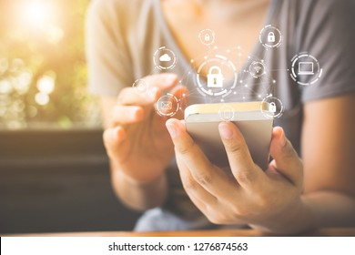 Woman using smartphone with icon graphic cyber security network of connected devices and personal data information
