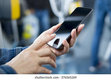 Woman using smartphone on bus. Sms, message, app