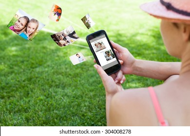 Woman using a smartphone on the grass