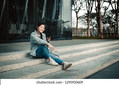 Woman using smartphone on street
