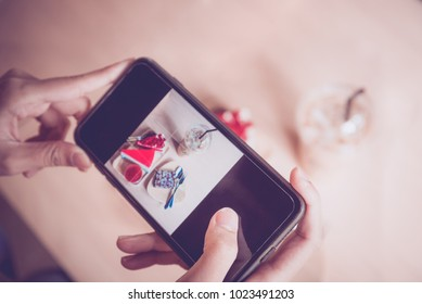 woman using smartphone take photo of delicious sweet dessert in  coffee cafe, Social media, Made from vintage filter effect, Vintage tone.