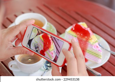 Woman using smartphones to take photos of food