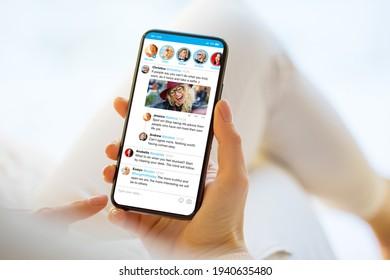 Woman using social media microblogging app on phone