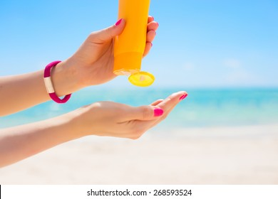 Woman using sunscreen