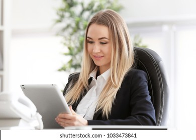 Woman using tablet computer indoors