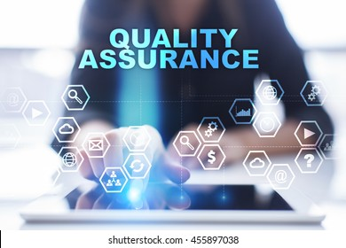 "Woman is using tablet pc, pressing on virtual screen and select ""Quality assurance""."